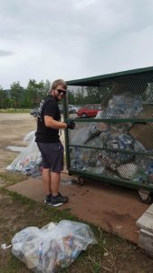 Volunteer Vincent Denis weighs festival garbage. Photo credit: Tremblant
